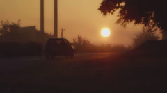 The car goes towards the sun in the early morning Stock Footage