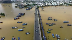 Aerial View of the Bridge Over the River, Traffic and the Island With Shacks Stock Footage