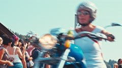 Spectators watch the custom motorcycles at the biggest biker parade in Europe Stock Footage