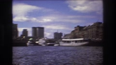 1975: amazing view of a large city with skyscrapers on the shore of lake BOSTON Stock Footage