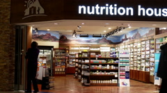 Nutrition house store closing down at night inside Coquitlam center mall Stock Footage