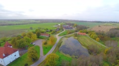 Old castle with red roof. Autumn nature landscape. Aerial footage. Stock Footage