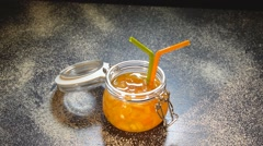 Slow motion, Jam From Orange In A Glass Jar Stock Footage