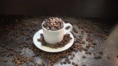 Slow motion. Coffee Grains Falling In White Cup Stock Footage