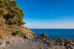 Ligurian stones beach Stock Photos