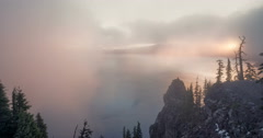 Sun Rising through fog time lapse at Crater Lake National Park Stock Footage