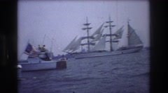 1976: ships sailing sea buildings people standing beautiful sight tourists Stock Footage