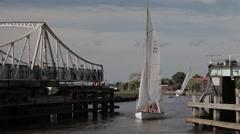 Yacht passing through Reedham Swing Bridge Stock Footage