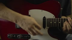 Playing Electric Guitar in the Recording Studio Stock Footage