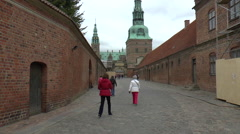 People Walking up an Old Cobbled Street Towards Frederiksborg Castle Stock Footage