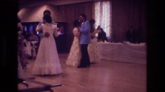 1974: men and women dancing slowly on the dance floor at a wedding BOSTON Stock Footage