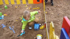Little Boy Playing In A Sandbox Stock Footage