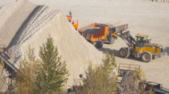 Loading the ore into heavy dump truck at the open cast mining site Stock Footage