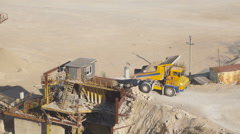 Large dump truck unloads the raw crushed stone crusher. Stock Footage
