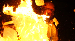 Slow Motion Firefighter Breaks a Burning Window 2 sshots Stock Footage