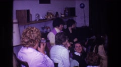 1974: family and friends gather around while the birthday girl opens up gifts. Stock Footage