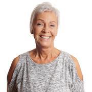 Happy senior woman with toothy smile Stock Photos