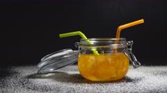 Orange Jam In A Glass Jar On Black Background. 4K Stock Footage