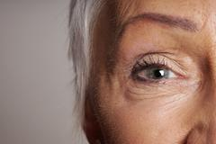 Close-up of mature woman with green eyes Stock Photos