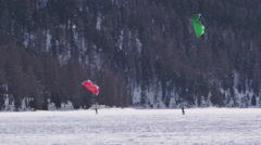 A kid learning to surf with a snow kite Stock Footage