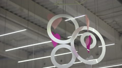 Decor of hearts and circles under the ceiling in shopping center Stock Footage