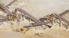 Stones crushing and gravel production on mining quarry. Raw mining materials Stock Footage