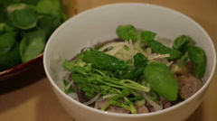 Chef prepare a bowl of traditional Vietnamese beef rice noodle, known as Bun  Stock Footage