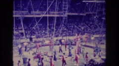 1974: circus event will all members, notably a tall man on stilts, are marching Stock Footage