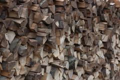 Pile of firewood fuel wood fills the whole frame Stock Photos