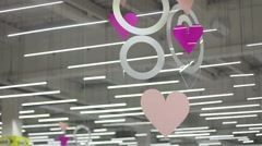 Hearts and circles under the ceiling in shopping center Stock Footage