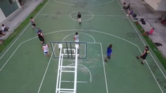Aerial drone - outdoor basketball game - slow motion jump shot Stock Footage