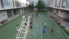 Aerial drone - outdoor basketball game with diverse group Stock Footage