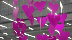 Many pink hearts and circles under the ceiling in shopping center Stock Footage