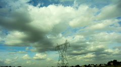 Clouds Moving Over Power Line Stock Footage