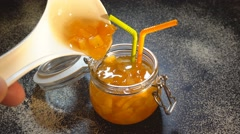 Jam From Orange In A Glass Jar. 4K Stock Footage