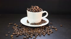 Coffee Grains Falling In White Cup. 4K Stock Footage