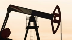 Oil field with Pump jack Stock Footage