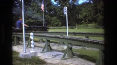 1975: family riding on a miniature train. BAXTER MAINE Stock Footage