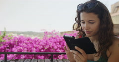 4K Portrait beautiful woman with smartphone outdoors with colorful flowers Stock Footage