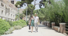 4K Attractive couple exploring the area in small Italian town - Editorial Stock Footage
