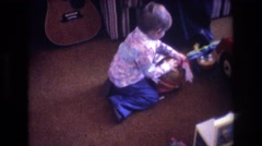 1975: little kid opening a gift. BAXTER MAINE Stock Footage