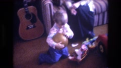 1975: cute child indoor playing and throwing a ball BAXTER MAINE Stock Footage