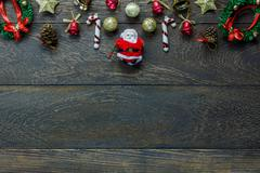 Top view Christmas decoration and Santa Claus doll on wooden background. Stock Photos