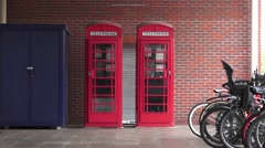 Two Red Telephone Boxes in England Stock Footage