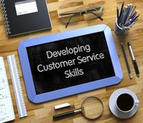 Small Chalkboard with Developing Customer Service Skills. 3D Stock Illustration