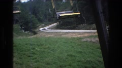 1976: sky lifts and race karts for today's journey. MT BROMLEY VERMONT Stock Footage