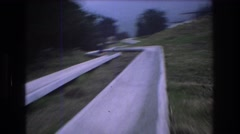 1976: fast riding on outdoor alpine slide concrete fun MT BROMLEY VERMONT Stock Footage