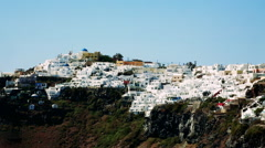 White houses line the hillsides of the Greek Island of Santorini. Stock Footage