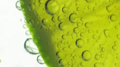 Sparkling bubbles water with a slice of lime. Slow motion macro footage. Stock Footage