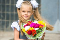 Up portrait of first-grader with a bouquet of flowers Stock Photos